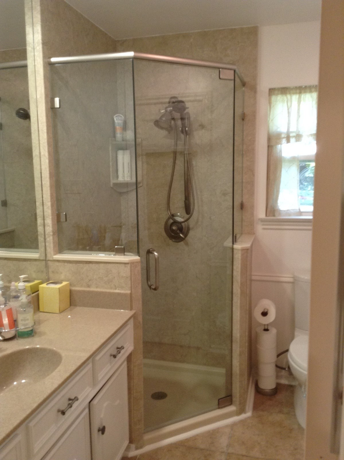 Pictures of new shower door and bathtub