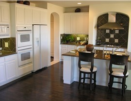 Wood Cabinets - Laminate Cabinets Photo 2
