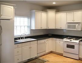Wood Cabinets - Laminate Cabinets Photo 4