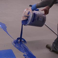 penntek-polyurea-shop-floor-pouring-ribbon